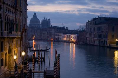 Day breaks over the Grand Canal in Venice looking towards the Basilica di Santa Maria della Salute  at dawn in Venice, Italy Europe
