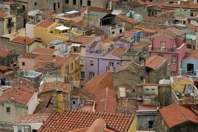 The red tiled roofs and colourful walls of the buildings in the town of Bosa on Sardinia, Italy Europe
