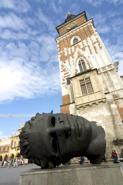 'Eros Bound' - a sculpture by Igor Mitoraj (2005) in the main market square - Rynek Glowny in front of the Cloth Market in Krakow Crakow in Poland Europe