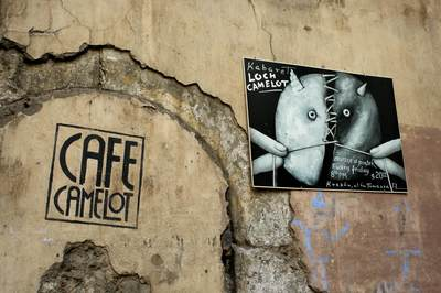Signage and posters on the exterior of cafe camelot in Krakow Crakow in Poland Europe