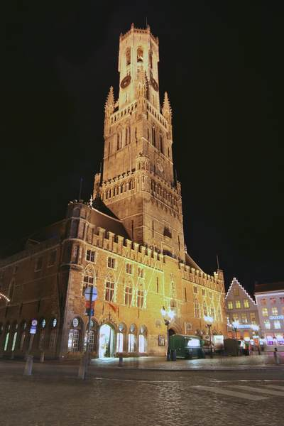 The tower of the Belfort (belfry) rebuilt in 1822 with a 47-bell Carillon and 366 steps to the top, with the cobbles of the Markt in the foreground in Brugges, Bruge West-Vlaanderen in Belgium Europe