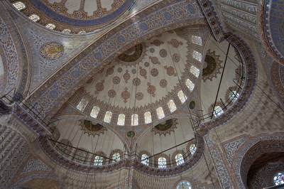 High ceiling and interior of the domes of the Blue Mosque covered in blue, white and gold Iznik tiles (giving the mosque its common name) with calligraphic roundels and fluted pillars, commissioned by Sultan Ahmet in Istanbul, Turkey, Europe