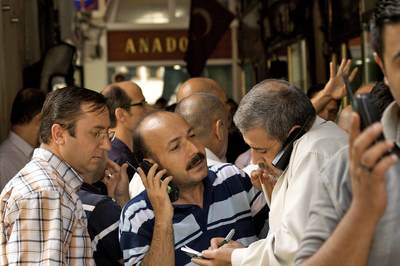 Turkish gold traders on telephones trade gold as the markets had just opened in the gold exchange of the Grand Bazaar (Kapali Carsi) in Istanbul, Europe