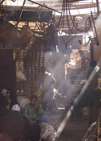 Blacksmiths working in the Ironmongers Souk in the Northern Medina in Marrakech Marrakesh in Morocco in Africa