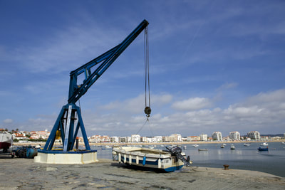 Marine hoist at the harbour in the small Portuguese town of Sao Martinho do Porto, Alcobaca, Leiria District, on the Silver Coast of Central Portugal, Europe
