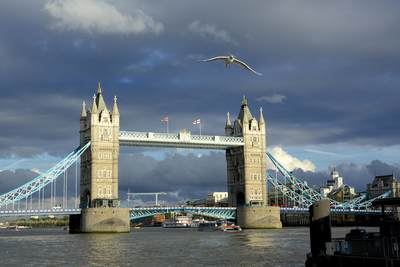 Tower bridge over the river Thames in central London with dark storm clouds behind in the United Kingdom