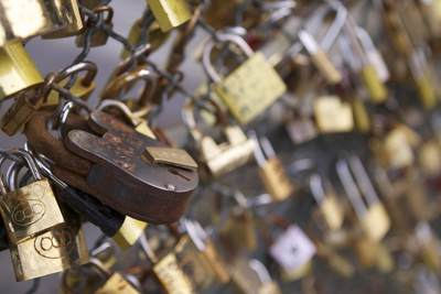 Padlocks attached to fences on the Pont des Arts bridge crossing the river Seine in Paris, France Europe