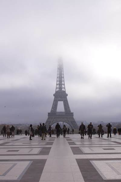 The Eiffel Tower shrouded in fog in winter viewed across the tiled Place du Trocadéro in Paris, France Europe